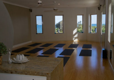 Yoga mats and views of Black Rock beach at Elevate Yoga studio